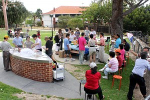 A scene of the bbq picnic with members and friends mingling and having a good time!