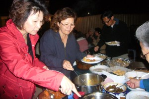 The sisters Sandra and Judy Vun savouring the different potluck Hakka dishes