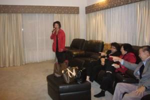 Judy Vun serenading while Dr Ching and other members enjoying her singing