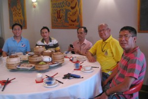 Keith taken to dim sum lunch by Mr Tim Mu (in red striped shirt) and elders and advisors of Hakka Association of Northern Territory in Darwin