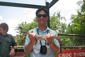 Keith with a baby crocodile at the farm