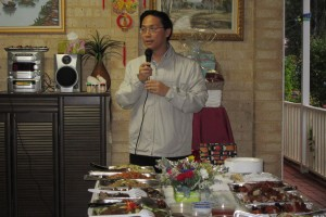 Executive Vice President Keith Yong 杨奕驹 addressing the crowd before commencement of the delicious food already laid out on the table