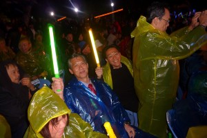 At the Opening Ceremony when it was an especially windy and cold night, and it rained later in the night. The 6,500 delegates were all gathered there and given lights and clapping instruments to heighten the atmosphere