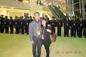 Even the security forces behind Norman and Annie Chia shown here at the Beihai Airport wore the World Hakka Conference official name tag around their neck