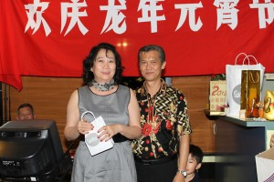 Sylvia receiving a prize from Senior Committee member Norman Chia