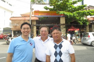 In front of the hawker food centre - President Keith Yong and members Dr Jeff Tee and Michael Cheah