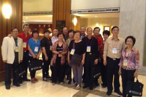 All 15 delegates taking a group photo first at the hotel before departing for the welcome dinner