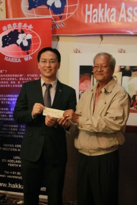 Honorary Advisor Mr Edward Kuh representing Da Vanti Homes presenting a cheque for $1,500 to the President as a donation to the Association, for members Alan and Lily Yit's building 2 houses through them