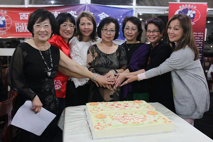 Cake cutting by all mothers